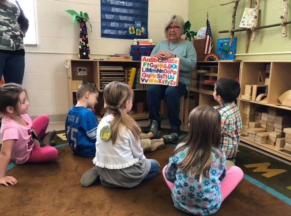 Mrs. Wilson reading to students